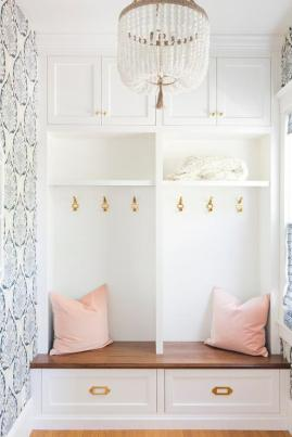 blue-lotus-mudroom-wallpaper-blush-pink-velvet-pillows-vintage-brass-pulls